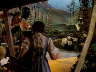 Dorothy opening the door upon Oz in the film