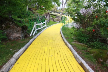 false apple trees loom around the bend in the yellow brick road